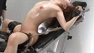 Nasty Asian slut in bondage gets her muff teased - 5:00