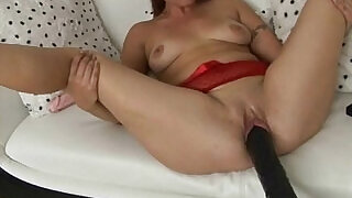 Brunette is plowed by a brutal dildo machine - 6:00